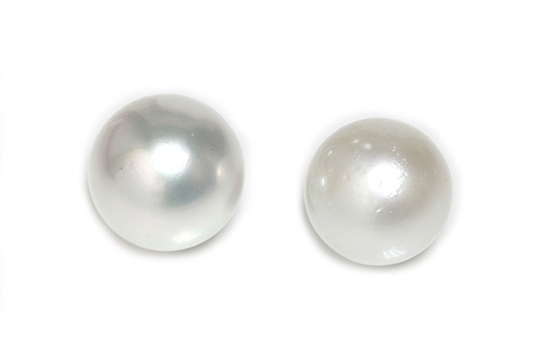 Why is surface clarity so important for pearls?